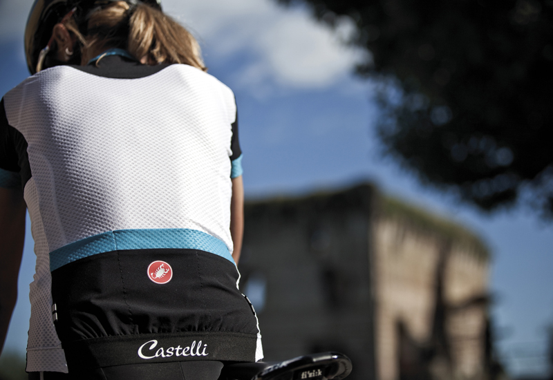 woman on bike in castelli gear